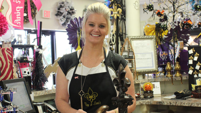 Elana Bourgeois-Folse displaying many of the products at the store.