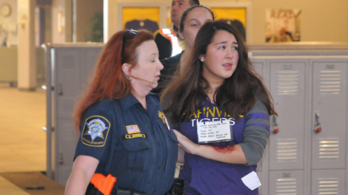 Police and student representation during the active shooter drill held at Hahnville High School last year.