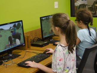 Minecraft players explore their world.