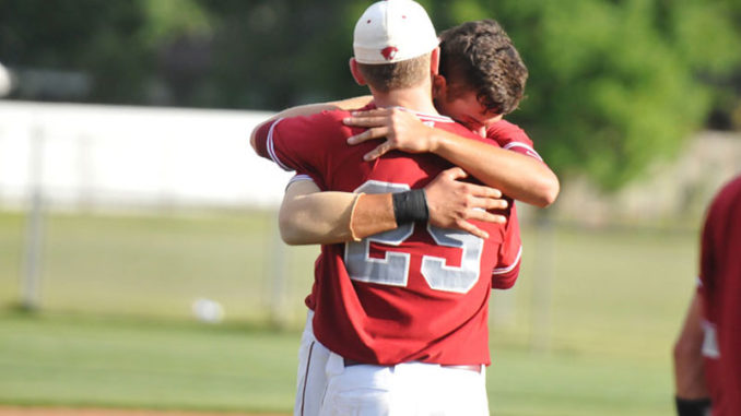 Destrehan players share a moment after Tuesday's playoff loss.