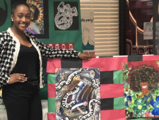DeJoan Mitchell displaying her art work she did at Destrehan High School.