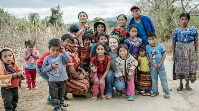 Kelsey King with children on missionary trip in Guatemala.