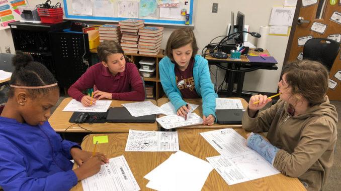Rayshonda McLeod, Kayden Samuels, Alena Daniels and Madison Treichler discussing relocation plans.