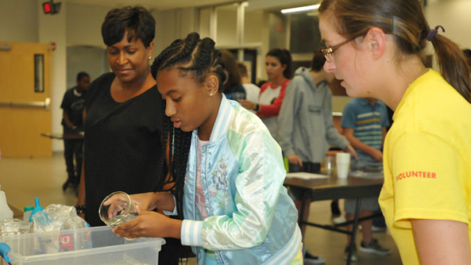 An experiment underway at Shell Norco's STEM camp at DHS.