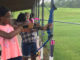 A camper tries her hand at archery during the first ever Operation First Class Sheriff's Camp for girls.
