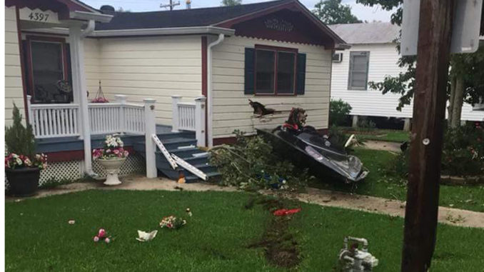 Boat that flew out of Bayou Gauche and into a resident's house across the highway.