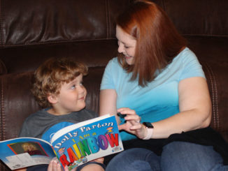 Erin Frickey reading to her son, Rory, who was diagnosed with autism.